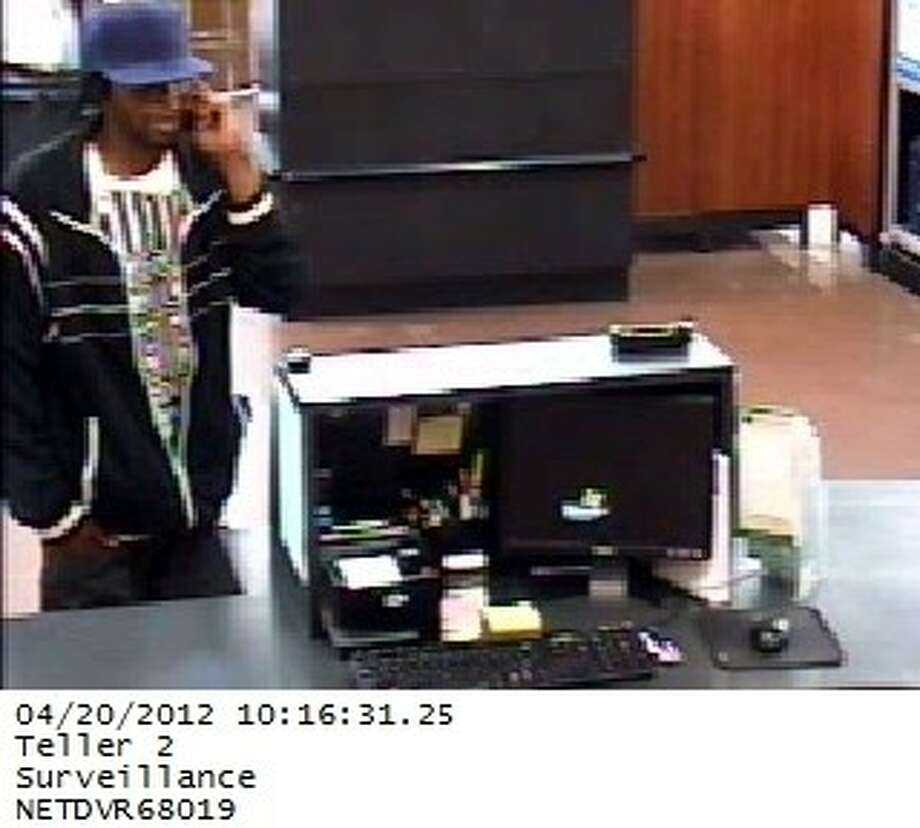 The FBI is hoping the public can help identify a suspect in a bank robbery that took place inside the Walmart at 9235 Sam Houston Parkway in Houston. One suspect is in custody, but one robber and the getaway driver fled the scene. The robbery occurred shortly before noon Friday. Photo: Submitted Photo