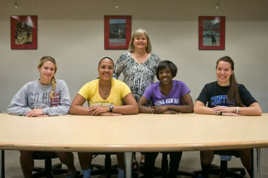 From left, Avery Lewis, Janette Batista, Monecia Preston and Rachel Dunlap all received scholarships to play volleyball at Division I schools. They are coached by Tracy Johnson.