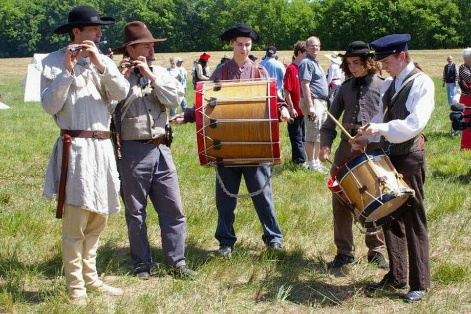 "Re-enactors in authentic Texas Army musician costumes from the Battle of San Jacinto are some of the people to meet during the ""living history lesson"" at the San Jacinto Day Festival on Saturday (April 20). Photo: SUBMITTED PHOTO"