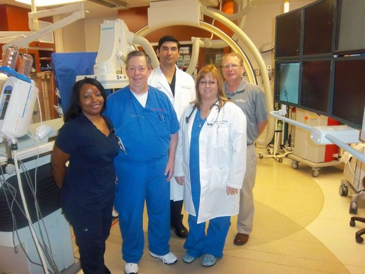 Congratulating R. Terry Jones, second from left, on his accomplishment as an accredited nurse infusionist are members of the Memorial Hermann Northeast Cardiac Cath Lab team - Ursula Gilstrap, Cath Lab clinical manager; radiologist Dr. Jesus A. Saenz, PICC team medical director; Dr. Jacquenette Chambers-McBride, member of the PICC team; and David Beck, director of Emergency Services.