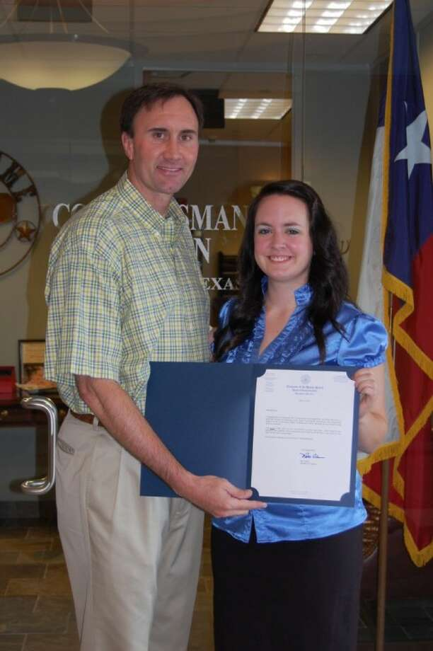 Rep. Pete Olson with winning artist Brittany Seay, a senior at Pasadena Memorial High School. Photo: SUBMITTED PHOTO