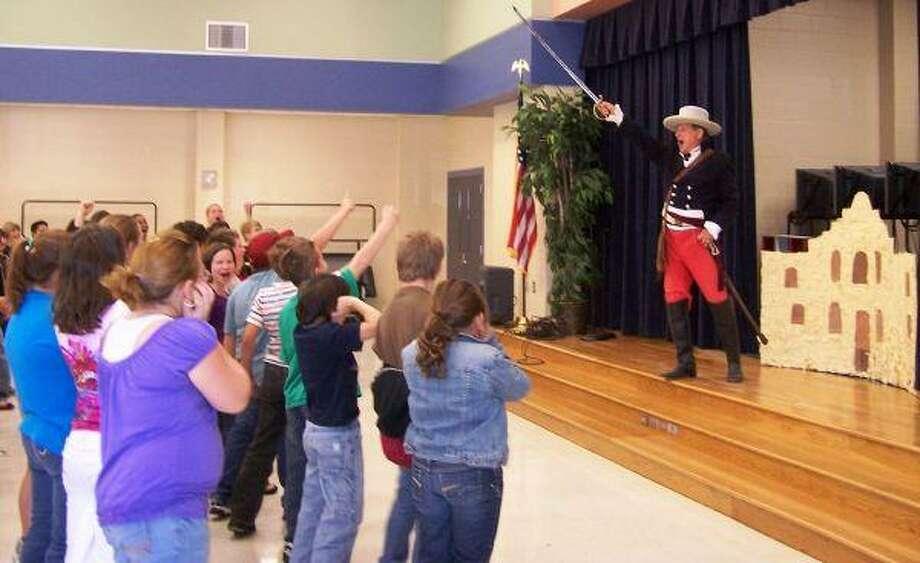 Historian and professional actor Bob Heinonen demonstrates his best William Barrett Travis at the Alamo presentation.