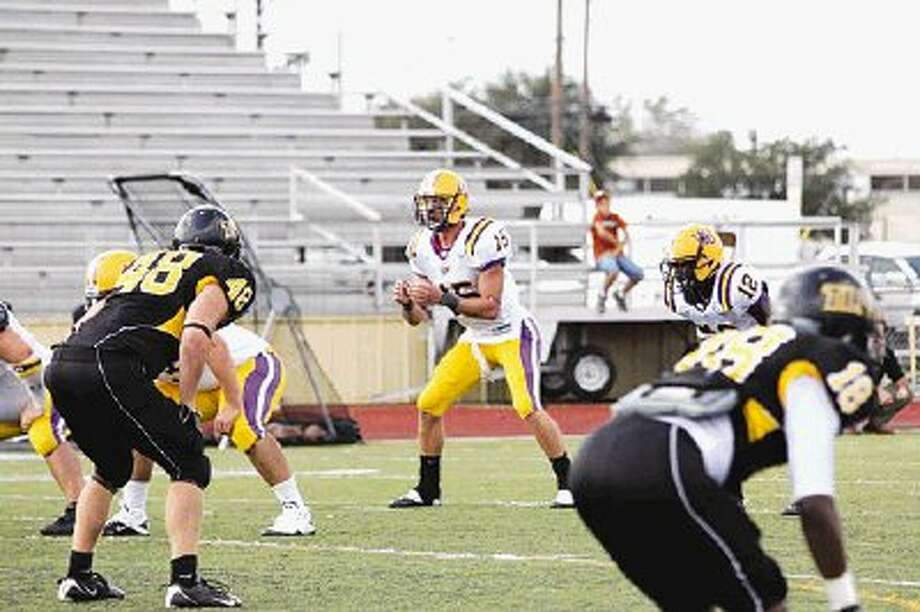 Hardin-Simmons quarterback Joshua Christian awaits a snap during a game in 2011.