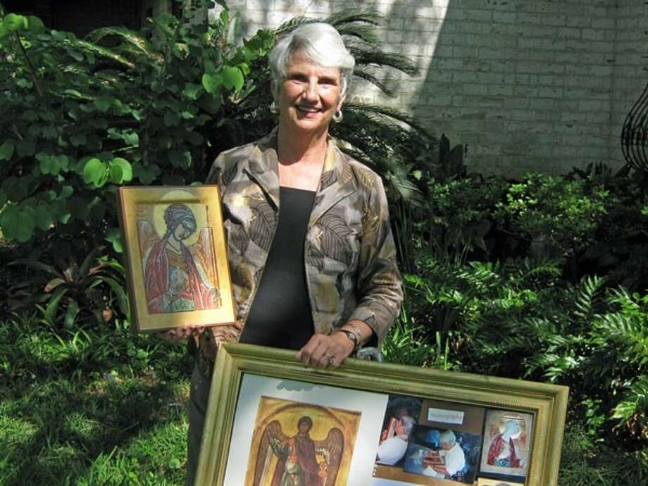 Denise Barkis displays some of the Christian icons she recently shared with members of the Liberty Art League. Photo: Submitted Photo