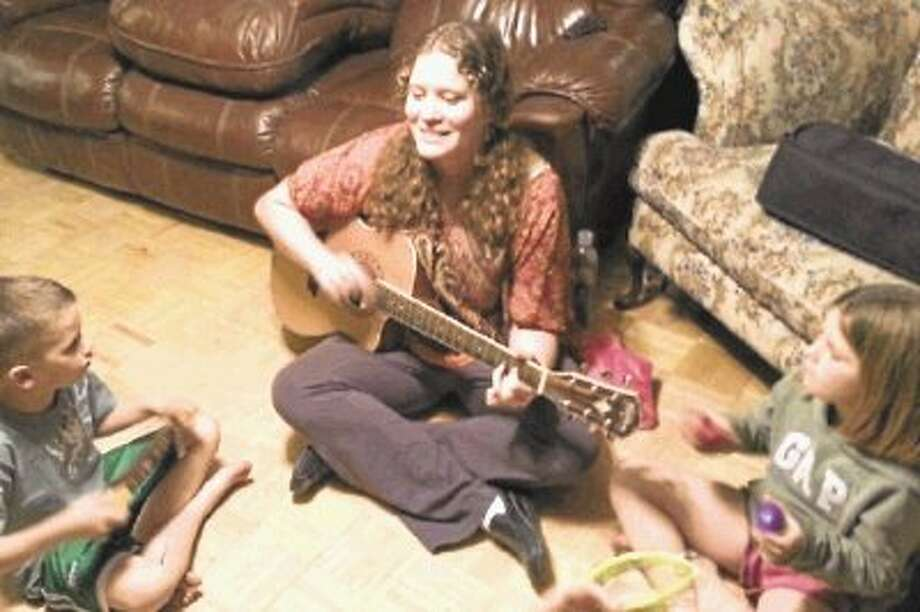 Local music therapist, Amanda Bayless, plays many instruments, including guitar, saxophone and piano. She incorporates these instruments, as well as many others, into her musical therapy lessons. / @WireImgId=2620682