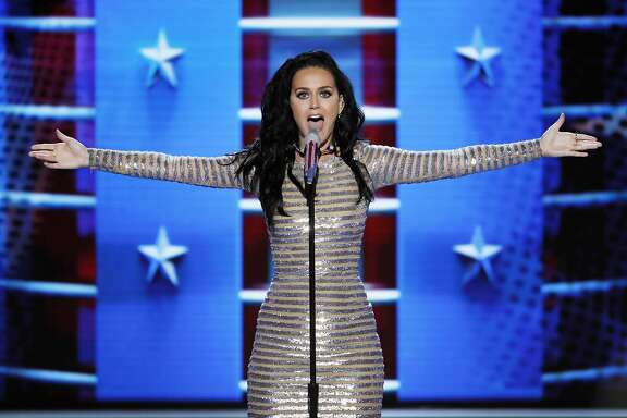 FILE - In this July 28, 2016, file photo, Katy Perry performs during the final day of the Democratic National Convention in Philadelphia. Perry stars in a new video posted by Funny or Die on Sept. 27, 2016, where she encourages people to get out and vote, no matter what they're wearing. (AP Photo/J. Scott Applewhite, File)