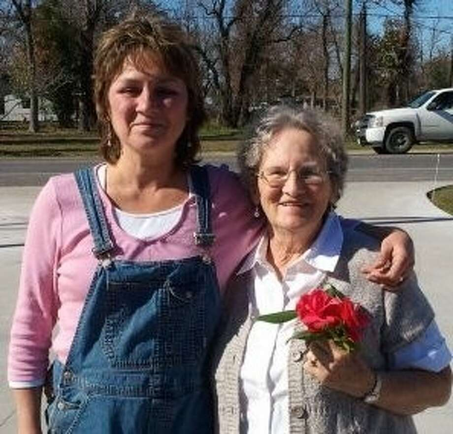 Kathleen Moore (left) operates Sisters Place in Dayton. She is pictured with her mother.