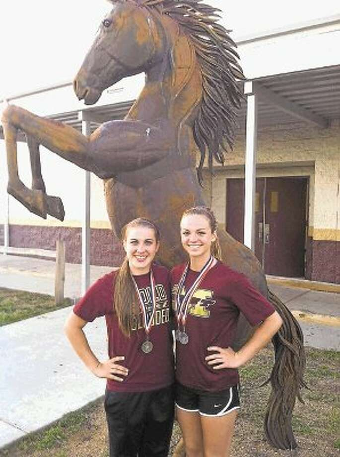 Magnolia West's Jessica Schobel (left) won the District 18-4A championship in the 100 meter hurdles. Mustang Erin Giles (right) finished second. Photo: David Fanucchi / @WireImgId=2622856