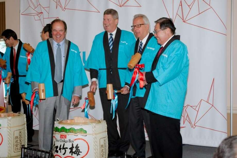 (From left) La Porte Mayor Louis Rigby, Kuraray America Vice President/General Manager Bob Chvala, Kuraray America President George Avdey and Kuraray President Fumio Ito participate in a traditional Kagami Biraki sake cask breaking ceremony as part of the ground breaking celebration of the new Kuraray plant being constructed in La Porte. Photo: Kirk Sides