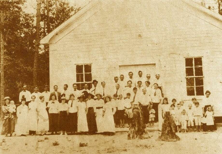 This 1916 photo shows some of the original members and founders of Dolen Baptist Church. The church's longest continuous member today is Mattie Bell Rollins, 92, who wasn't even born at the time this photo was taken. Photo: Submitted Photo