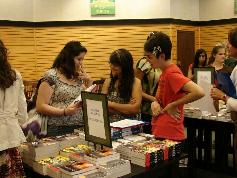 WHP volunteer teens help Summer Reading Program participants make their required reading selections. Photo: Submitted