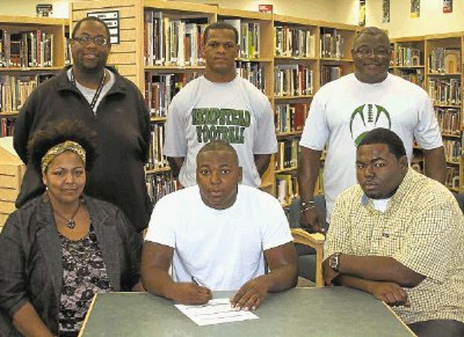 Hempstead High School Senior Deon Thompson signed a letter of intent to play football for East Texas Baptist University in Marshall, Texas. Pictured from the left are (front row) Deon's mother, Regina Thompson; Deon Thompson; Deon's brother, Jerard Thompson; (back row) Offensive Coordinator Royce Hill; Defensive Coordinator Andre Crumedy and Head Football Coach Ricky Sargent. / @WireImgId=2411892