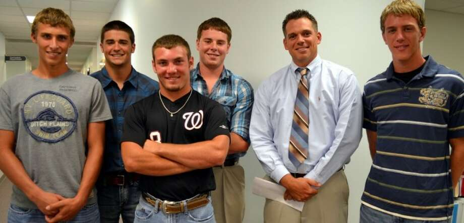 The Waller High School baseball team had several players receive 17-4A district honors. The players and coach pictured were recognized by the school board at the June 13 meeting. Pictured from the left are Race Mellman, who was named second team outfield; Matthew Pierce and Eric Huffman, who were named honorable mention; Trent Rape, who was named first team pitcher; head coach Kyle Humphreys; and Rhett Loewe, who was named honorable mention.