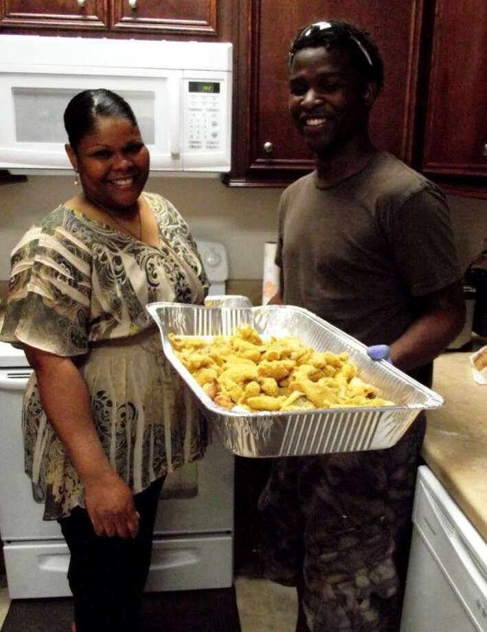 Annie Eldridge Lee and her nephew Justin Eldridge show off a tray of the delicious fish served as part of the catfish fry fundraiser held by Spring Hill Baptist Church for Deacon Robert Eldridge on Friday, April 20. Photo: CASSIE GREGORY