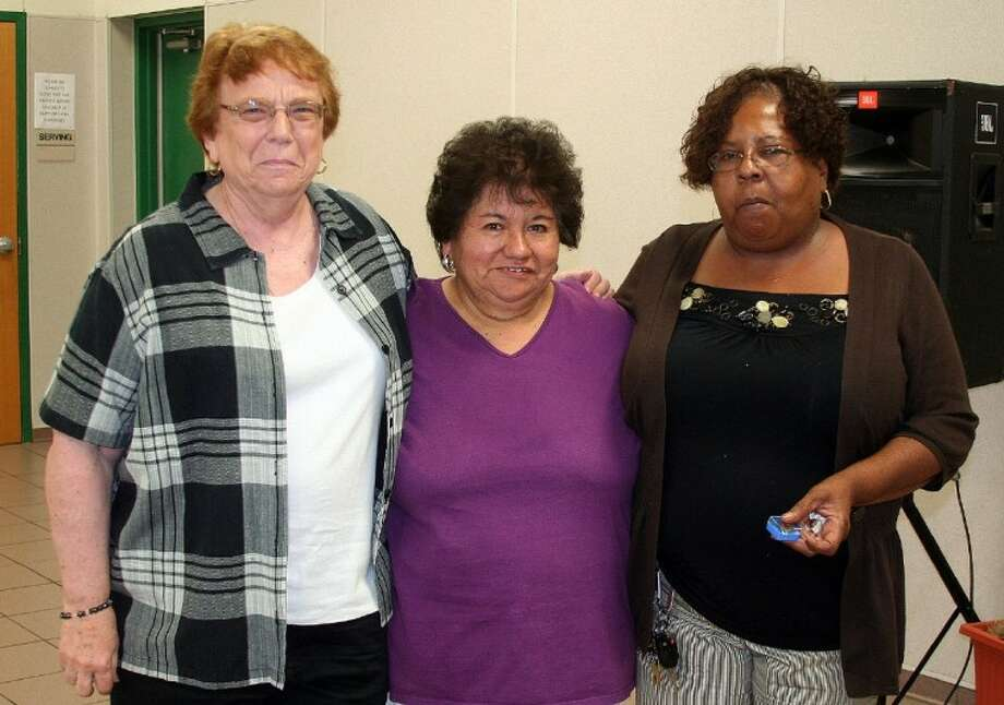 Hempstead ISD service awards honorees, pictured from the left, Fran Politi, Elvira Munos and Nelda Jackson were recognized and received pins for 25 years of service to HISD during the annual awards luncheon on May 31.