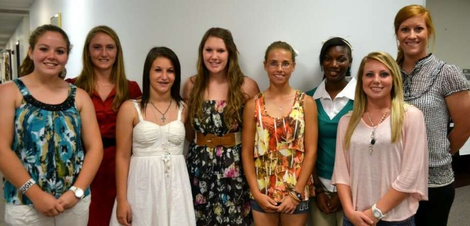 Several Waller High School softball players received 17-4A district honors. The girls were recognized by the Waller ISD school board at the June 13 meeting. Pictured from the left are Academic All District honorees Katie Schmidt and Samantha York, honorable mention: Shelby Lalumandier, second team pitcher: Jill Loukanis, honorable mention: Cheyanne Carter and Samitra Weathers, first Team Infield: Lauren Young, and head coach is Candi Weige. Not pictured are: Academic All District and second Team Infield: Briana Knowles and first team outfield: Rachel Rawlings.