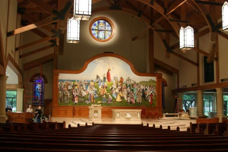 The new Mary Queen Catholica church features a large mural depicting the Gospel of John account of the feeding of the 5,000 using only five loaves of bread and two fish. The original artwork was painted by renaissance artist Andrew Hattermann. Photo: KRISTI NIX