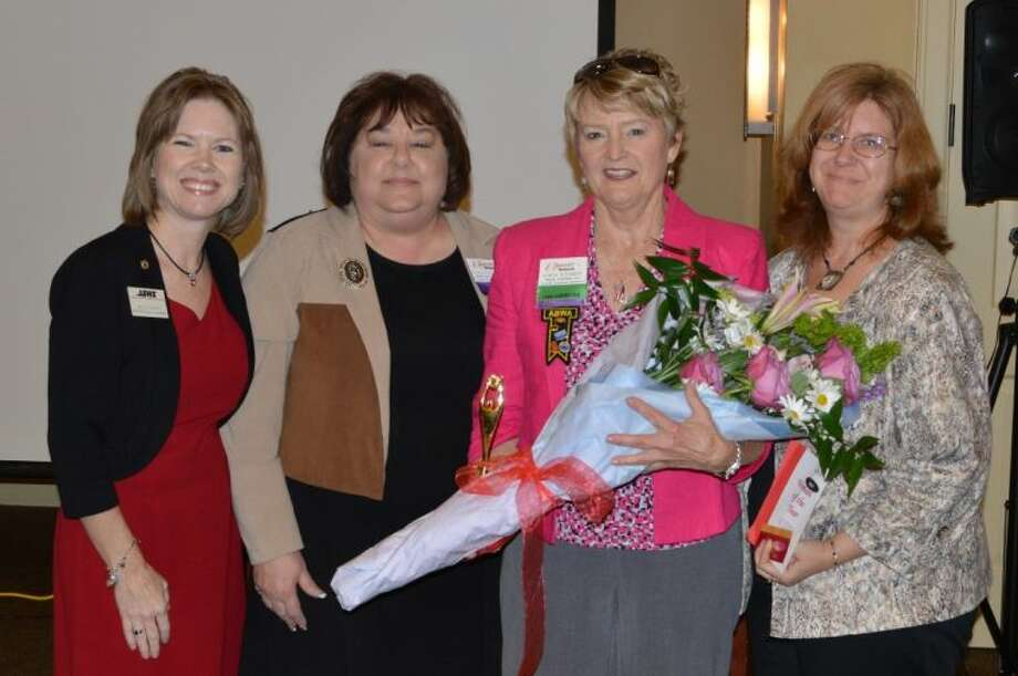 From left are ABWA District II Vice President Gaylyn DeVine, CYFEN's Phyllis Oustifine, awards chair, Woman of the Year Kathi Schmidt and Kelly Ann Norton, Vice President of Marketing.