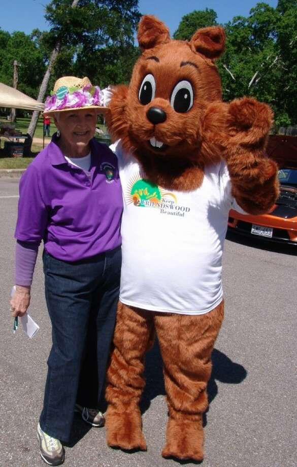"""Loretta Murphy (left) and the yet-unnamed """"Keep Friendswood Beautiful"""" mascot squirrel greeted people at the Fig Festival and Car Show in Stevenson Park on Saturday (April 21). Photo: JEFF NEWPHER"""