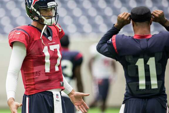 Houston Texans quarterback Brock Osweiler (17) talks to  receiver Jaelen Strong (11) during practice at NRG Stadium on Wednesday, Sept. 28, 2016, in Houston.