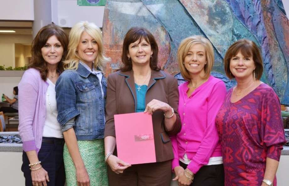 Melissa Preston and Carrie Hyman, the 2013 co-chairs of Memorial Hermann In the Pink of Health, and Megan Alexander and Ruth Hiller, the 2011-12 event co-chairs, present Trina Hans, of The Rose, with funds raised to support uninsured women in Montgomery County.