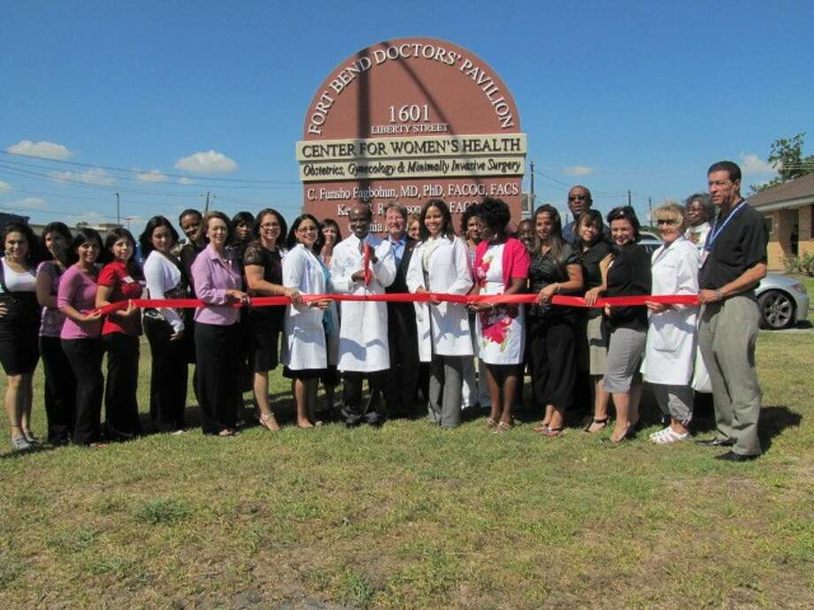 The Central Fort Bend Chamber Alliance recently held a ribbon-cutting ceremony for th eCenter For Women's Health, 1601 Liberty Street, Suite A in Richmond): Pictured: Pam Campion, Alicia Ramirez, Stephanie Oregon, Yazmin Aleman, Keila Garcia, Yolanda Stredick, Evalyn Moore, Yinka Fagbohun, Maria Rodriguez, Dr. Cynthia Rios, Dr. Funsho Fagbohun, Garry Gillen, Dr. Bernadette Bonaparte, Leslie Fernandez, Kesha Robertson, Veronica Ortiz, Stephanie Uballe, Joel Bonaparte, Angie Sanders, Sue McCarty, Fawaz Massis.