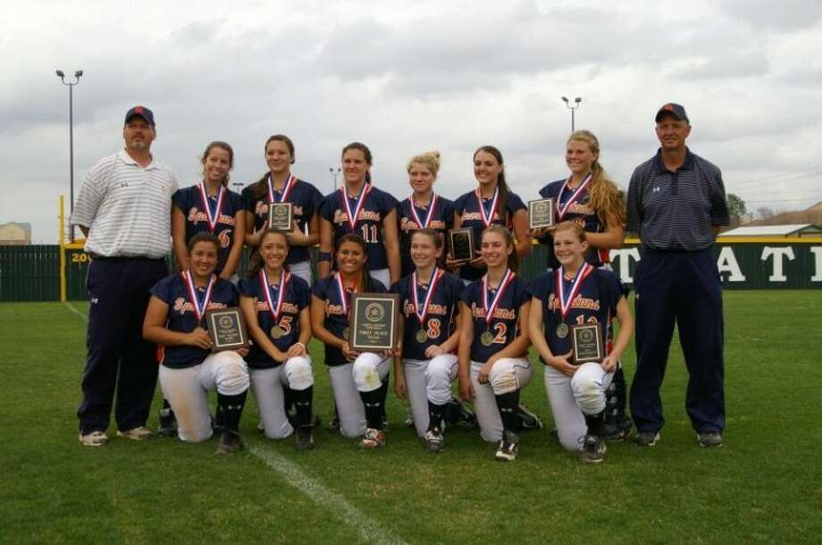 The Seven Lakes softball team is pictured after winning the Spring Branch ISD tournament earlier this season. Head coach Terry Knagas, who is on the far right, retired earlier this month.