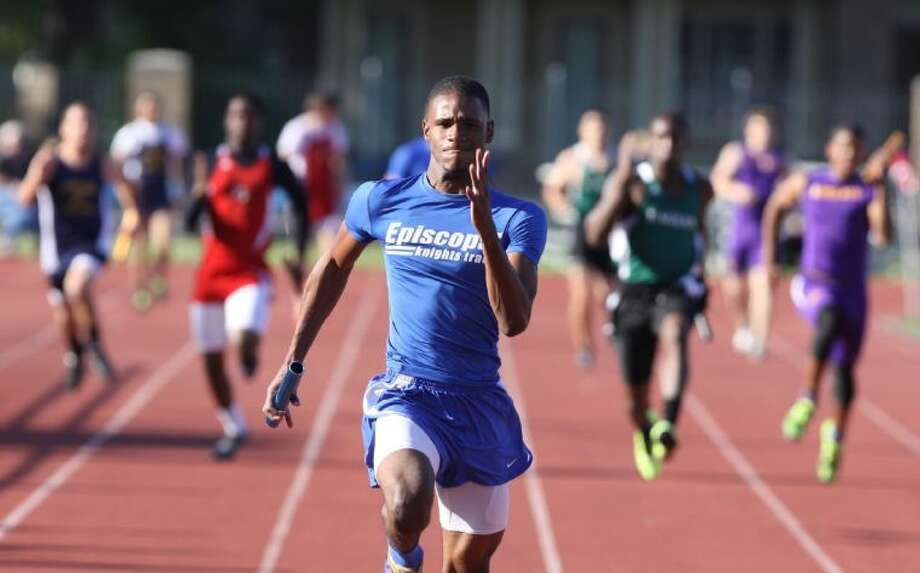 Episcopal' senior sprinter Curtis Brown has a big lead in the Boy's 4 x100 Meter Run at the Episcopal Relays in Houston. Brown, who is headed to the University of Arkansas on a track scholarship, won the 100 and 200-meter races at the Episcopal Relays Friday. Photo: Photo By Alan Warren