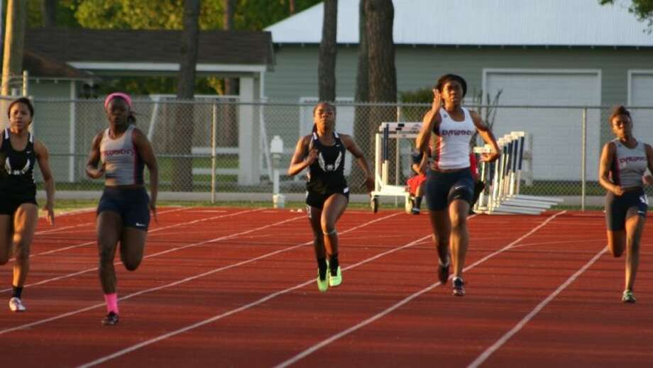 Dawson sprinters (left to right) Erica Davis, Cybil Obiozor, and Monique Berry compete in the finals of the 200 meters. Davis finished second, Obiozor took third and Berry placed sixth. Photo: SUBMITTED PHOTO