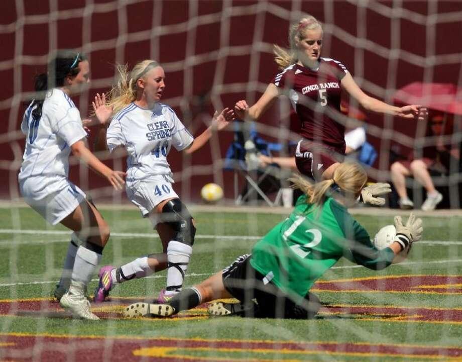 Clear Springs goalkeeper Anna Hughes stops a shot from a Cinco Ranch player Friday during a Region III-5A girls' soccer semifinal. Photo: KAR HLAVA