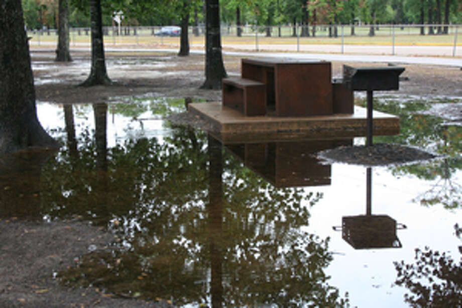 With the downpour on June 22, certain parts of Meyer Park, located at 7700 Cypresswood Drive, overflowed with rainwater. Photo: By SATARA WILLIAMS THE SUN
