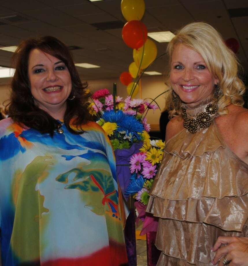 Lunar Rendezvous Festival Kickoff Chairman Dr. Kimberly Weathers, left, and Festival General Chairman Jill Reason smile as the crowd begins arriving at UH-Clear Lake. Photo: Mary Alys Cherry