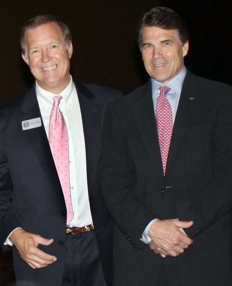 State Rep. Randy Weber (left), candidate for U.S. Representative District 14 was recently endorsed by Texas Governor Rick Perry (right). Photo: KRISTI NIX