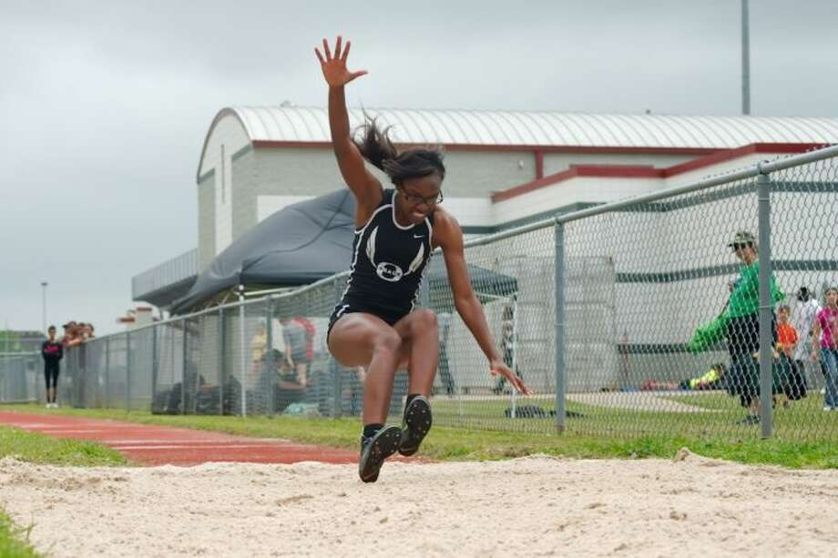 Pearland's Tiara Johnson, shown here winning the triple jump last week in the District 22-5A track meet, also won the 100 and 200 meters and was a member of the Lady Oilers' winning 400-meter relay team. Photo: KIRK SIDES