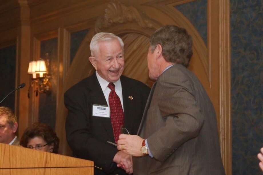 Pearland Mayor Tom Reid introduces Harris County Judge Ed Emmett during the BayTran State of the Counties Address Wednesday, Apr. 10. Photo: Kirk Sides