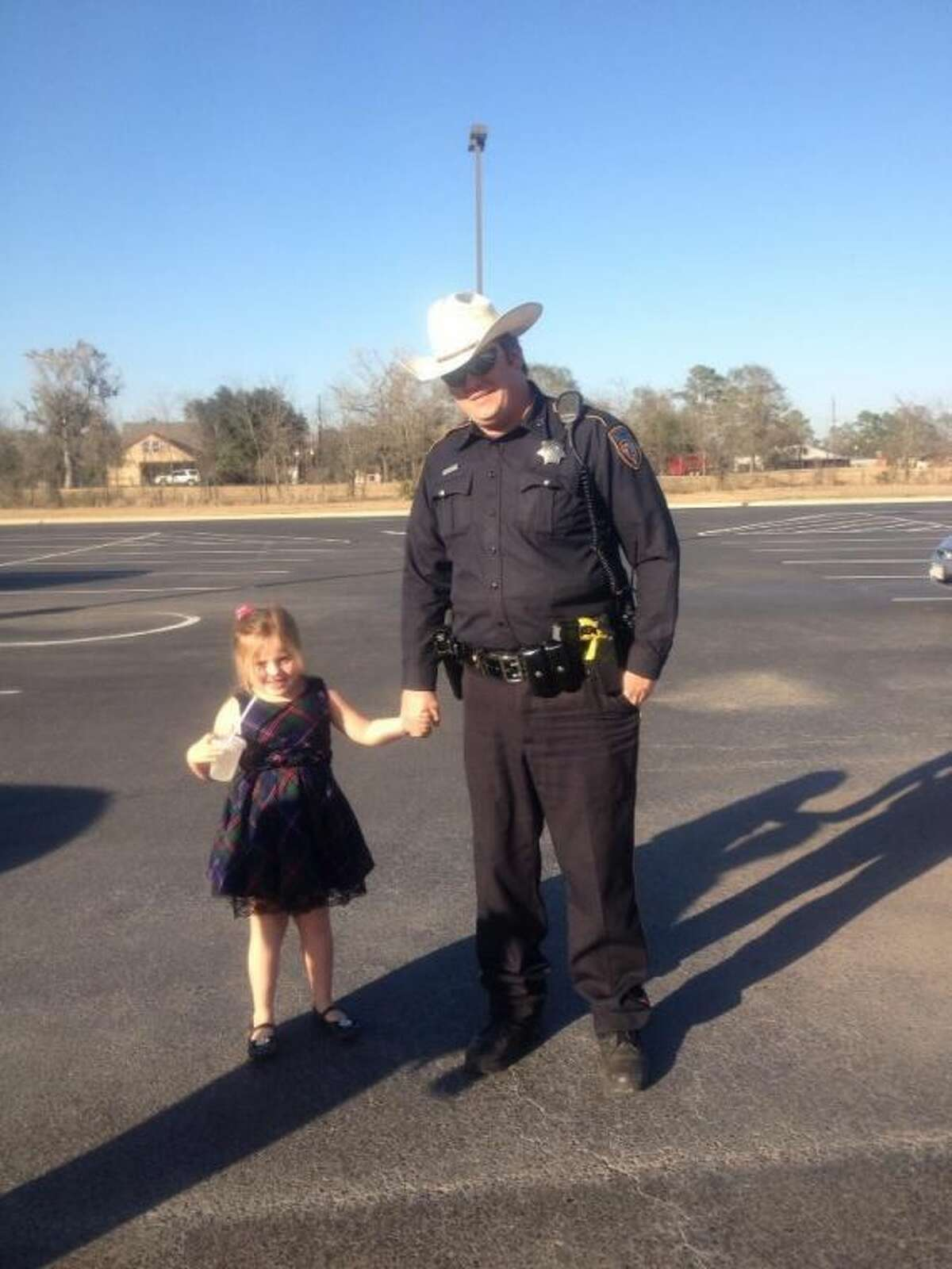 Harris County Sheriff's Office Deputy Brian Bevil spends time with his daughter, Lexi.