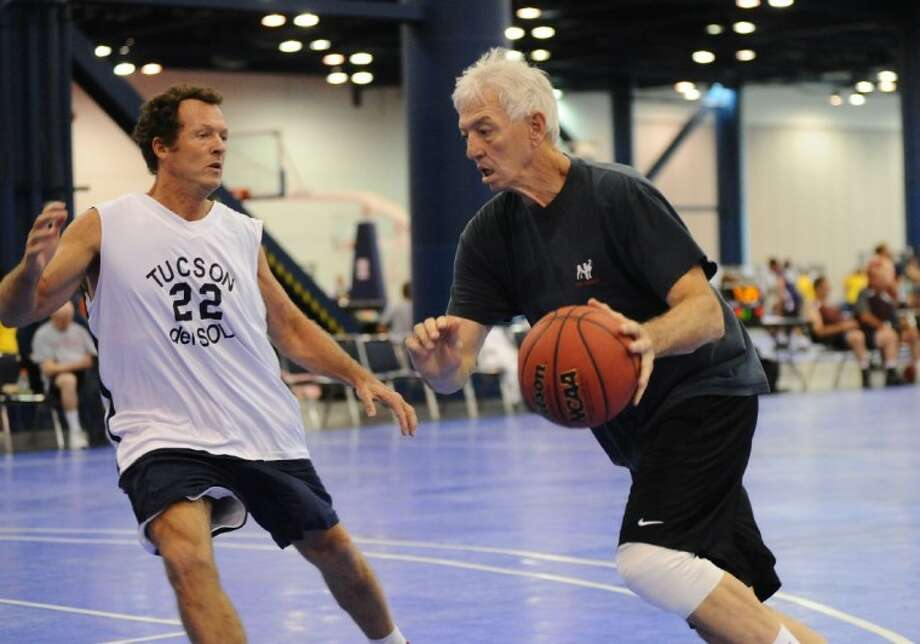 Greg Layton drives to the basket in the men's 50-54 age bracket on 3-on3 basketball competition during the 2011 Summer National Senior Games.