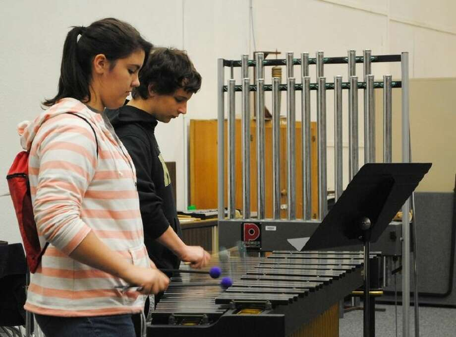 Two Danbury High School students perform in the percussion section during a workshop on April Photo: ACC