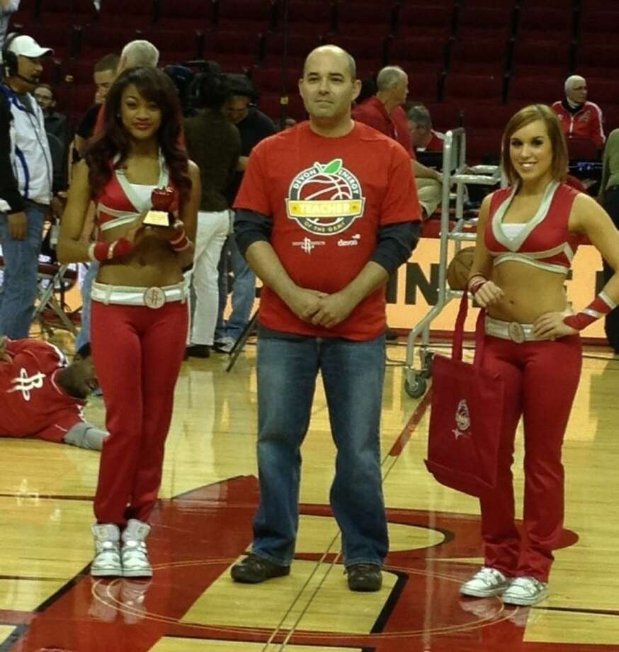 Wilson is shown with Houston Rockets Cheerleaders at halftime during the March 3 game.