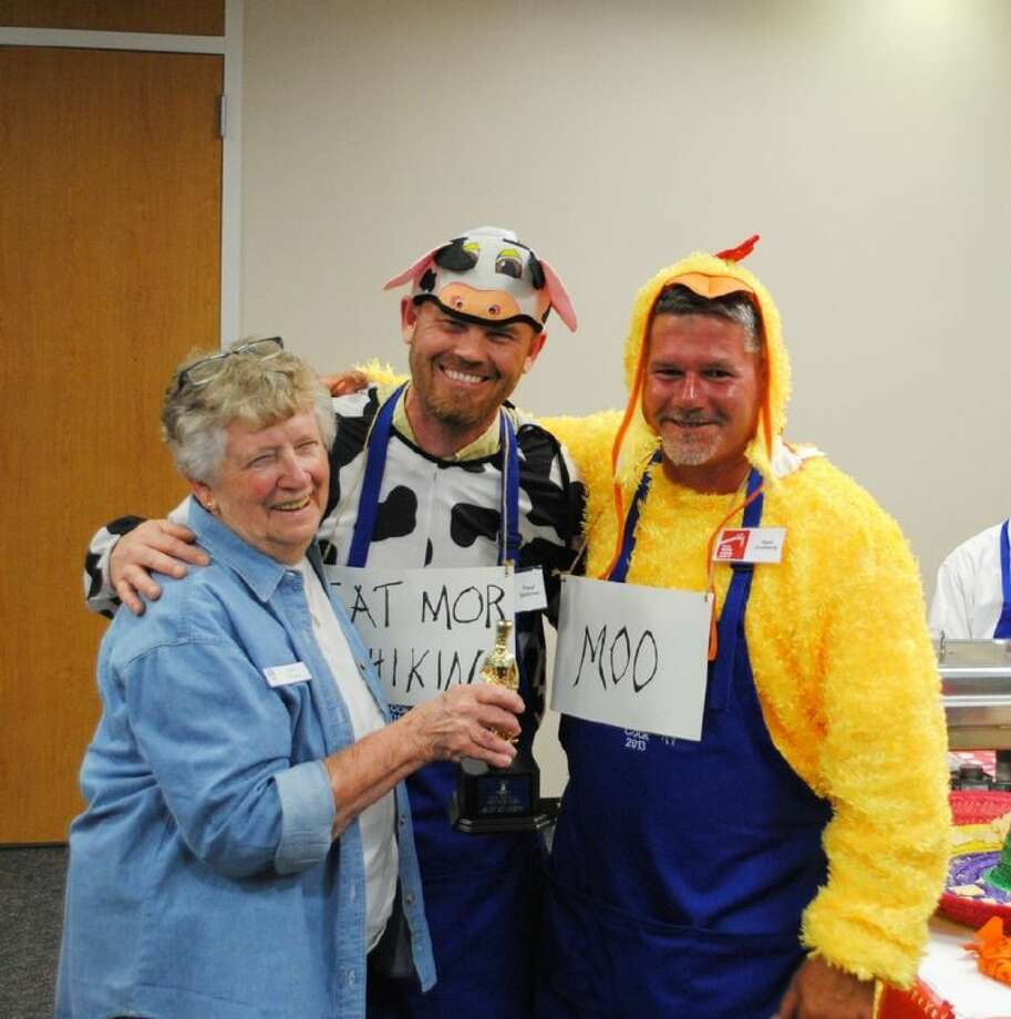 Soroptimist International of Alvin President Joan Young, left, presents Paul Selover and Paul Froberg with the award for best of show during the Men Who Cook event on March 22. Photo: Submitted Photo