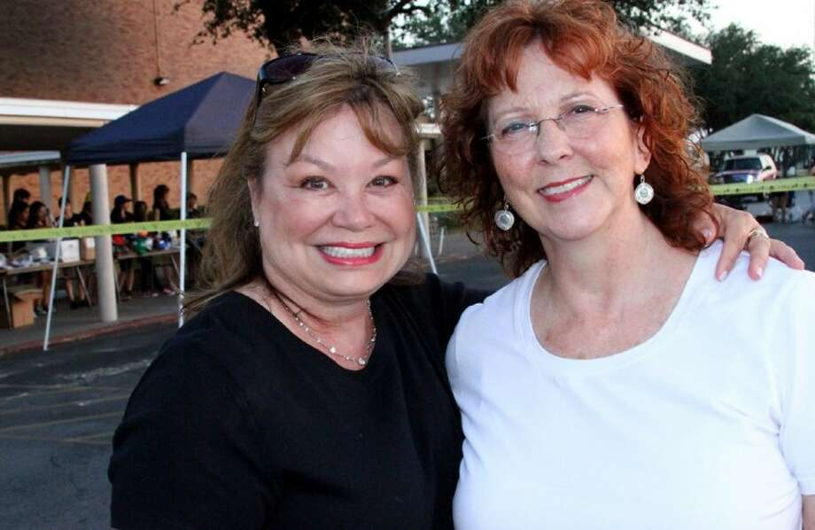 Susan Duff greets garage-sale customer and high-school friend Brenda Hughey Putnam, a former Jannette who now serves as the librarian at Gardens Elementary. Photo: Courtesy Pasadena ISD