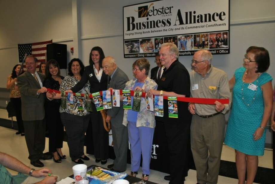 Representatives of the six attractions part of the Houston-Galveston Attractions Association and Webster city councilmembers join to cut the ribbon for their new partnership at the Wednesday (April 18) Webster Business Alliance at the Webster Civic Center.