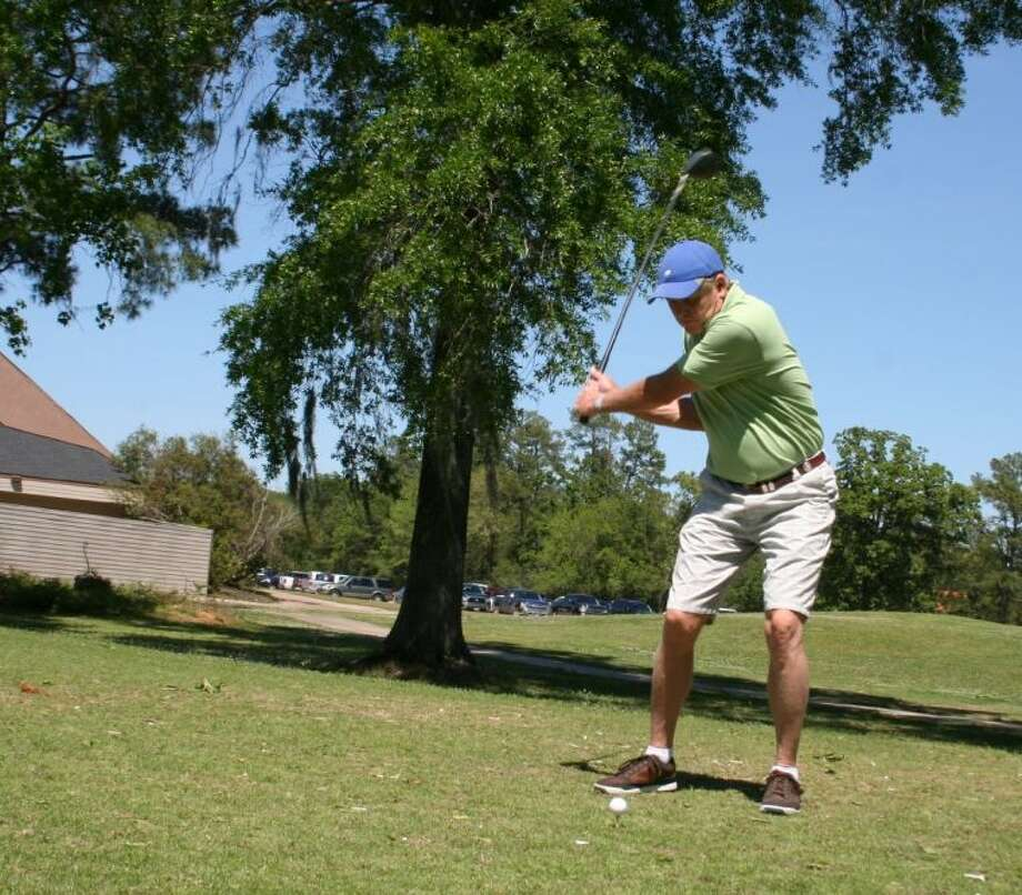 Forrest Germany swings at the ball during the Tees-n-Tails Golf Tournament sponsored by the Crosby Huffman Chamber of Commerce. The tournament included a game of golf, an onsite crawfish boil and an evening of awards. Photo: MELECIO FRANCO