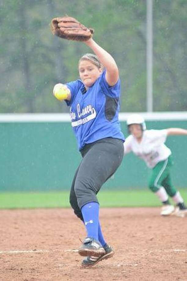 New Caney pitcher Ariel Kellogg's development on the mound is a big reason why the Lady Eagles are a game out of first place in District 14-5A. (Photo by Jose Quiroz/The Observer) / © by Jose Quiroz 2009