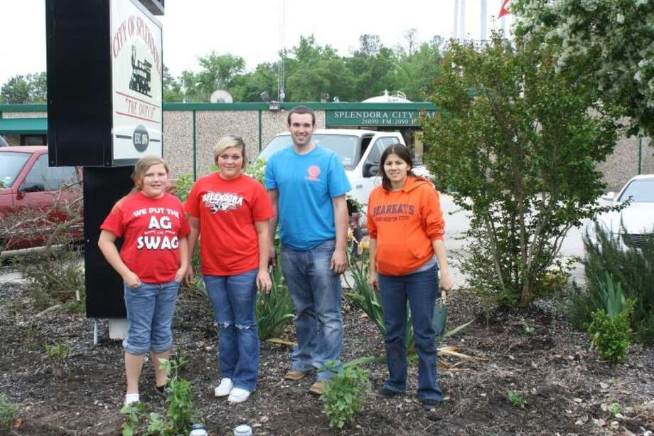 Madison and Hannah Wiggins, along with Sam Houston State University student teachers, Jared Lynch and Patricia Hollis, spent time working on the landscape in front of Splendora City Hall on April 2 and April 3. Photo: Submitted Photo