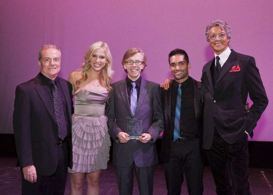 (Left to right) TUTS CEO and President John Breckenridge, Stephanie Gibson, Manuel Santos and Tommy Tune congradulate Friendswood's Mason Patterson (center) on his Tommy Tune- Best Supporting Actor Award. Photo: BRUCE BENNETT