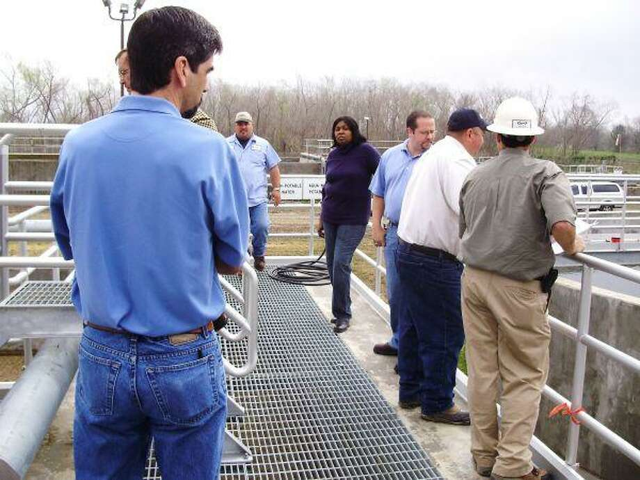 Arcola Mayor Maryetta Anderson and City Administrator George Farland, along with a number of others, tour recently completed sewer treatment plant.