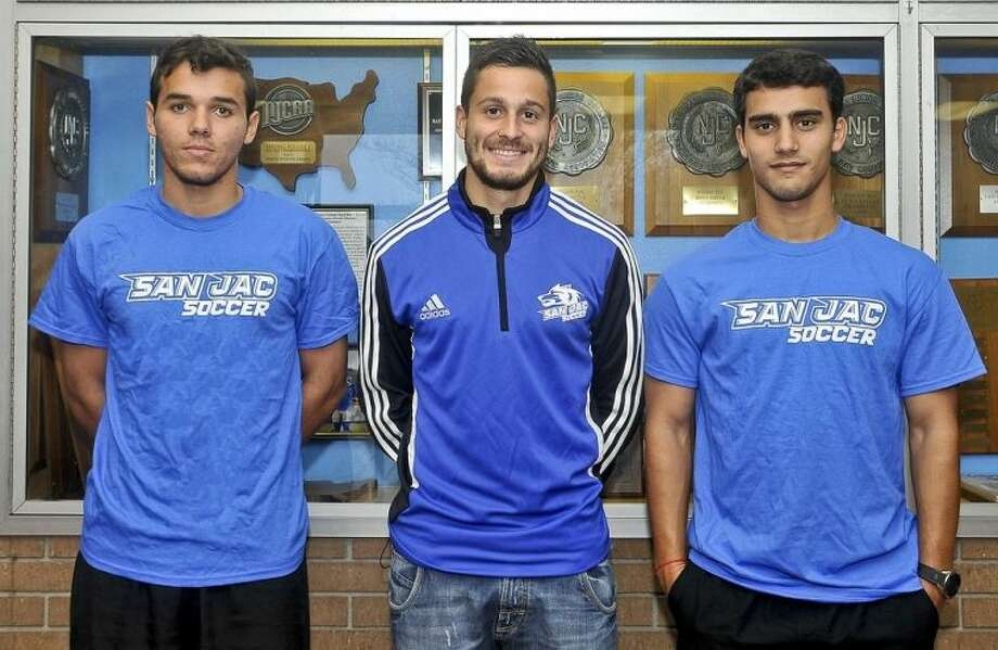 Rodrigo Holden (center), San Jacinto College sophomore defender, has signed to continue his education and soccer career at the University of St. Thomas in Houston. Also pictured: San Jacinto College Men's Soccer Interim Head Coach Ian Spooner (left) and University of St. Thomas Soccer Head Coach Aaron Champenoy (right). Photo: Jeannie Peng-Armao