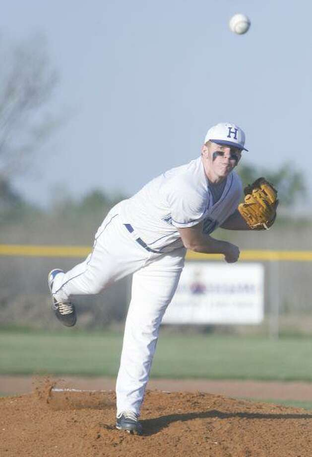 Right handed pitcher Myles Taylor pitches the ball during the opening inning against Buna on Tuesday, March 30, in Hardin. Taylor gave up six runs in the inning, mostly due to defenive errors.