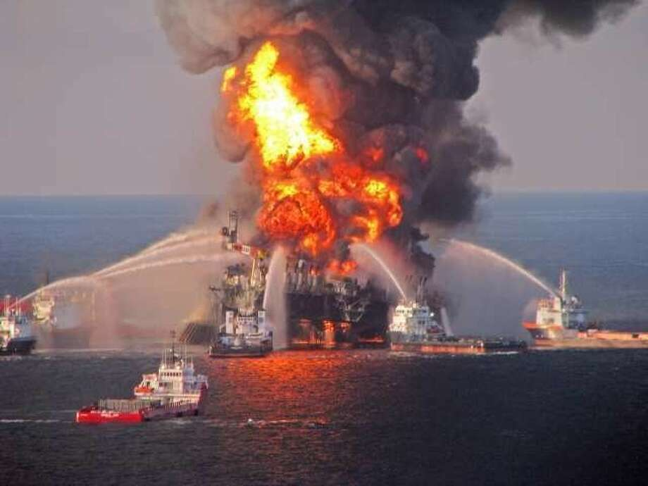 This photo released by the U.S. Coast Guard on April 22, 2010 showed fire crews battling the flaming spill from the BP Deepwater Horizon platform in the Gulf of Mexico the preceding day. A Katy engineer became the first person to face criminal charges in the case Tuesday. / EPA FILE